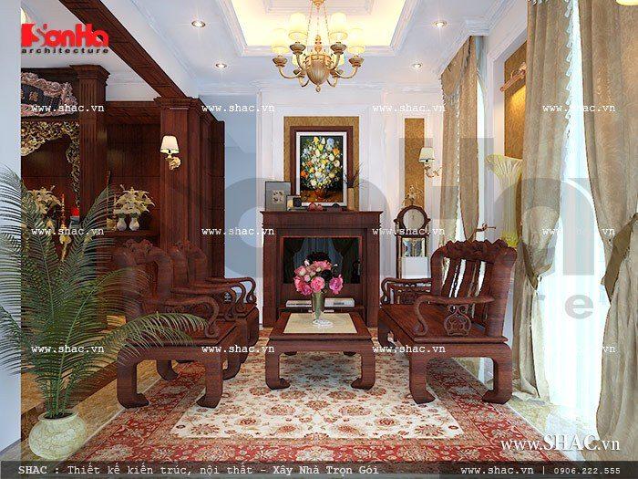 Thiết kế nội thất phòng khách mang phong cách cổ điển đẹp nổi bật với bộ ghế đồng kỵ ấn tượng