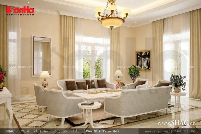 Mẫu thiết kế nội thất phòng khách sang trọng với điểm nhấn nổi bật là bộ ghế sofa êm ái của biệt thự hiện đại