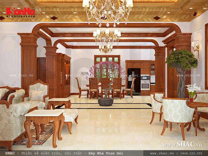 Phòng khách cổ điển có thiết kế nội thất gỗ chủ đạo là không gian đón tiếp khách trang trọng và lịch thiệp