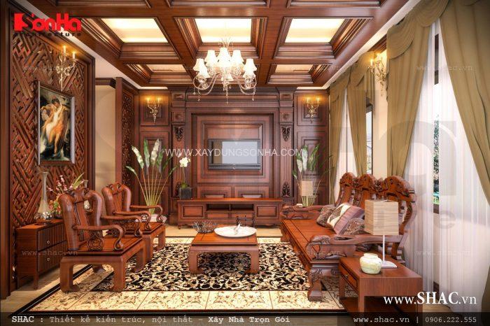 Thiết kế nội thất phòng khách đẹp với bàn ghế gỗ cao cấp, trang trọng mang đến cảm giác gần gũi cho các vị khách khi ghé thăm
