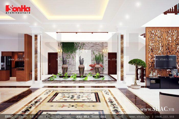 """Không gian phòng khách rộng, thoáng đãng với gạch ốp lát cao cấp tạo nên nét sang, là """"bộ mặt"""" đại diện cho công trình biệt thự hiện đại."""