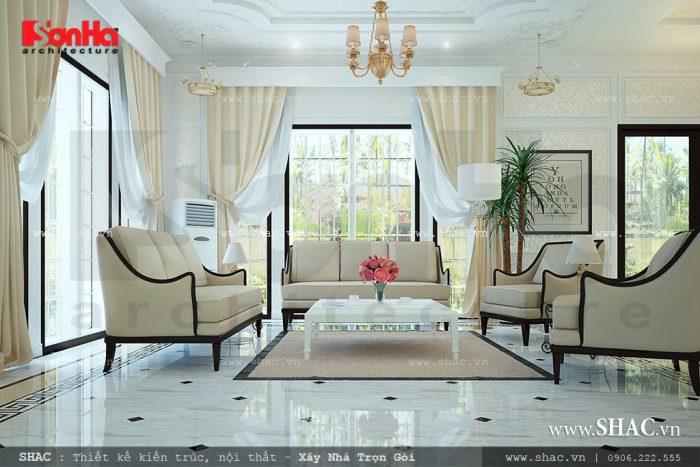Mẫu thiết kế nội thất phòng khách hiện đại sang trọng với bộ ghế sofa êm ái cùng cách trang trí ấn tượng