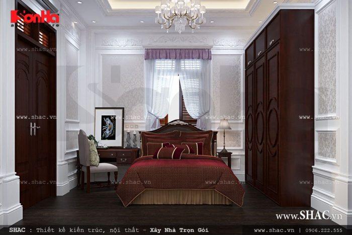 Phòng ngủ biệt thự đẹp và nồng ấm với gam màu đỏ đô trầm ấm hòa quện với nội thất gỗ trong phòng