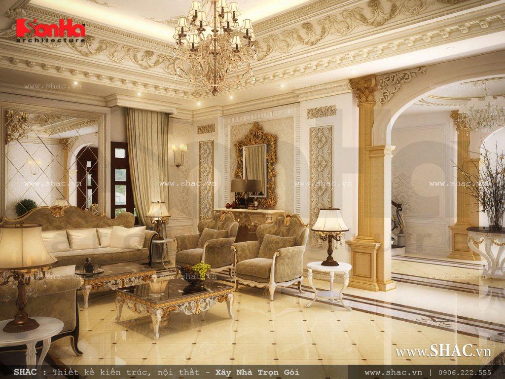 Mẫu thiết kế nội thất phòng khách với màu sắc nhã nhặn kết hợp với hệ thống đèn tạo nên một không gian sang trọng