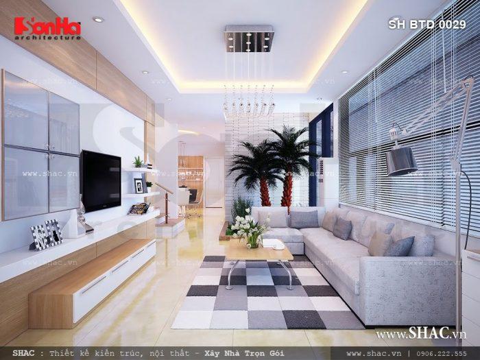 Thiết kế nội thất phòng khách biệt thự hiện đại sang trọng và tinh tế nổi bật bởi bộ ghế sofa nhỏ nhắn êm ái