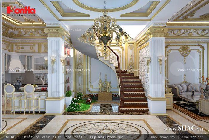 Khu sảnh thang tại trung tâm tầng 1 của ngôi biệt thự kiểu Pháp 3 tầng được thiết kế sang trọng và bố trí hợp lý phân chia khu vực phòng khách và bếp ăn