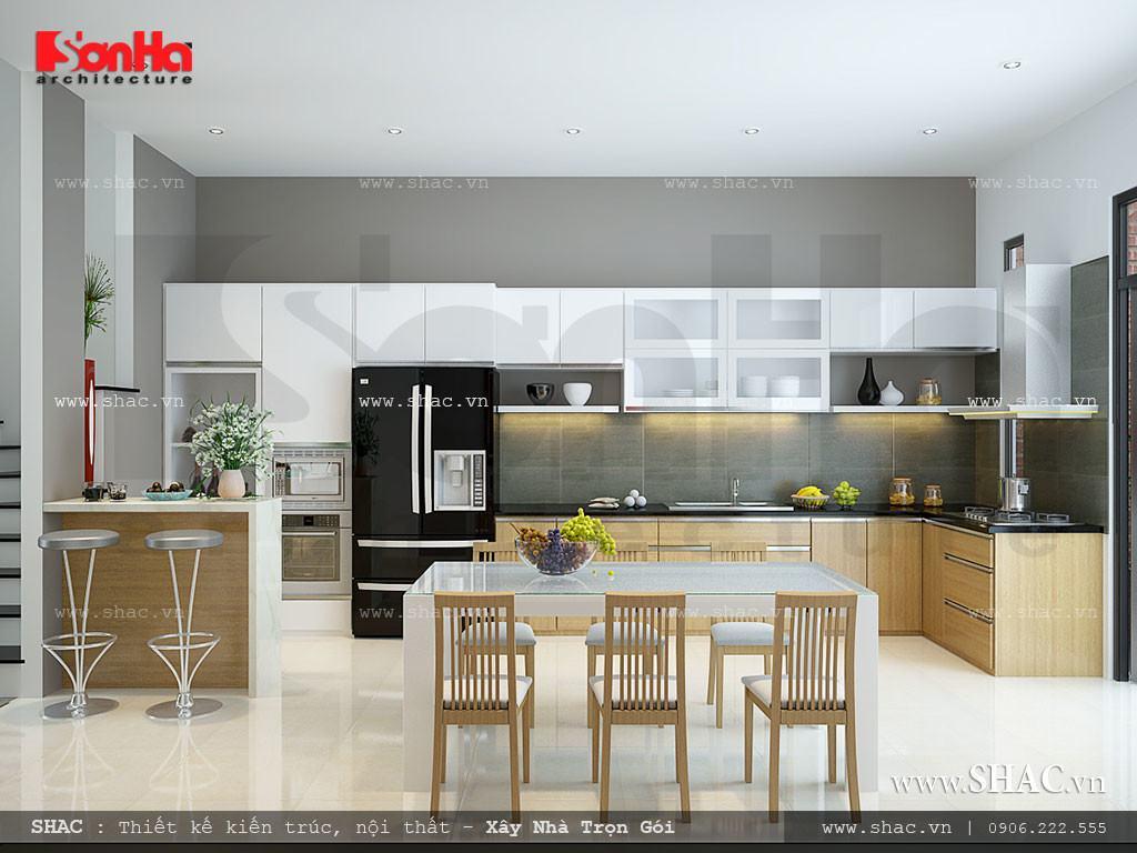 Hình ảnh: Toàn cảnh không gian bếp ăn hiện đại được bố trí khoa học và đẹp mắt. Phòng khách rộng
