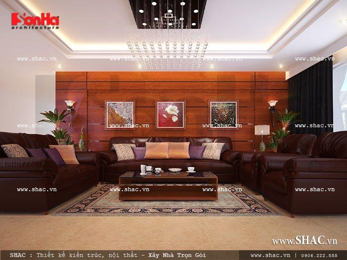Sự kết hợp giữa hai gam màu trắng của trần và màu nâu cá tính của bộ sofa không gian phòng khách biệt thự hiện đai thật trẻ trung và nổi bật