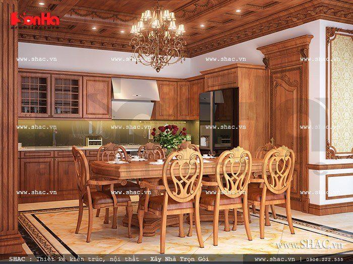 Vẫn lựa chọn chủ đạo chất liệu gỗ, không phòng ăn và bếp được thiết kế nội thất sang trọng cùng bày trí ngăn nắp và phù hợp với diện tích sàn tầng 1