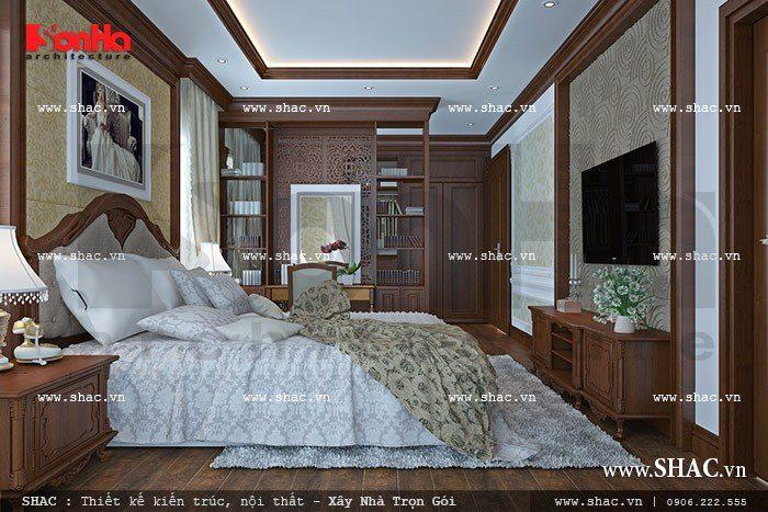 Phòng ngủ của vợ chồng gia chủ được thiết kế nội thất gỗ ấm cúng tiện nghi trong không gian diện tích phù hợp