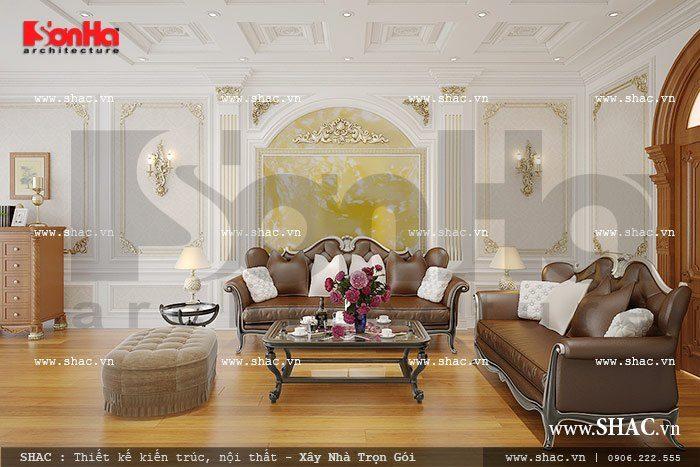 Điểm nhấn trong mẫu thiết kế nội thất phòng khách biệt thự này thể hiện qua bộ ghế sofa êm ái với gam màu cổ điển tinh tế