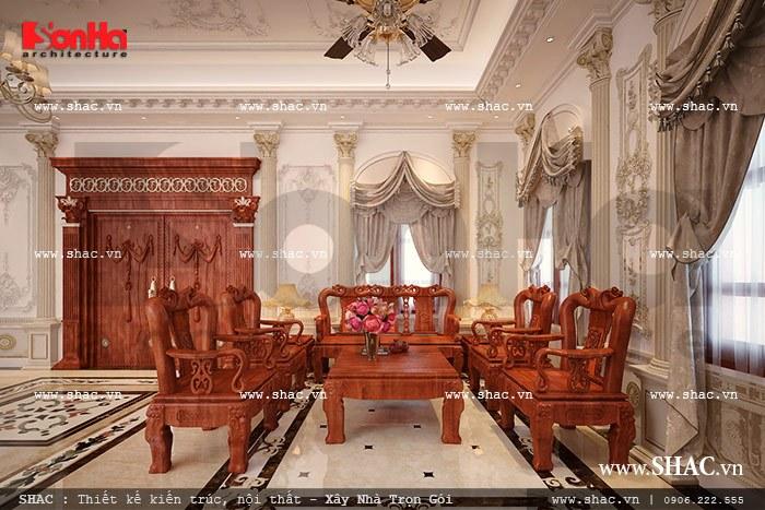Thiết kế nội thất phòng khách biệt thự kiểu cổ điển sang trọng nổi bật với bộ ghế gỗ đồng kỵ cao cấp