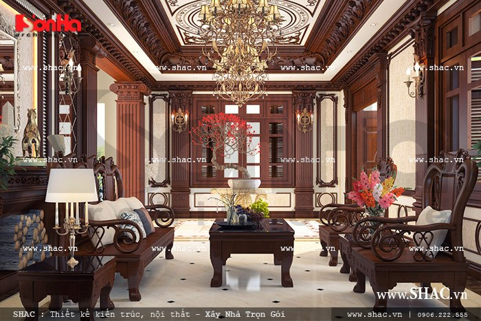 Mãn nhãn với mẫu nội thất phòng khách sử dụng gỗ đồng kỵ cao cấp mang tới sự quý phái và sang trọng cho không gian đón tiếp khách của ngôi biệt thự