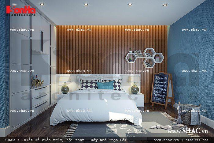 Mẫu phòng ngủ dành cho bé trai mang cá tính mạnh mẽ với sắc xanh ấn tượng được lựa chọn để thiết kế nội thất