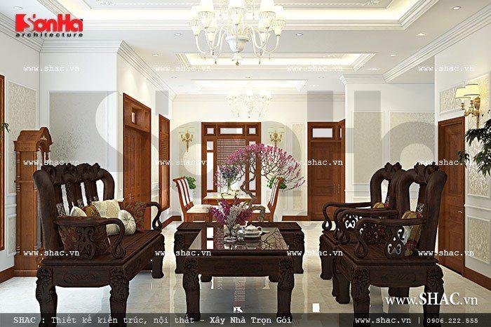 Bộ bàn ghế đồng kỵ đẹp mắt được bố trí vừa vặn trong không gian của phòng khách biệt thự cổ điển