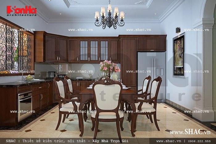 Không gian phòng bếp ăn với nội thất gỗ chủ đao được thiết kế khá ngăn nắp gọn gàng trong không gian thoáng đãng