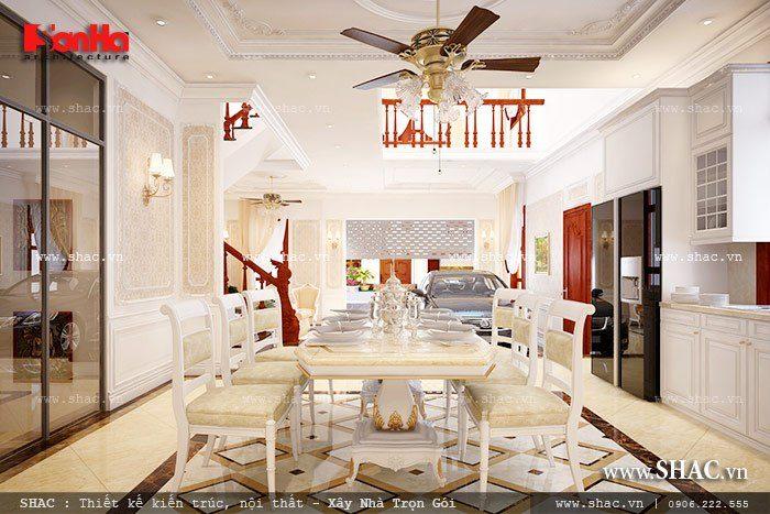 Mẫu thiết kế phòng bếp ăn ngay tại tầng 1 của biệt thự với bộ bàn ăn đẹp mắt được bố trí hợp lý và hài hòa trong không gian phòng bếp