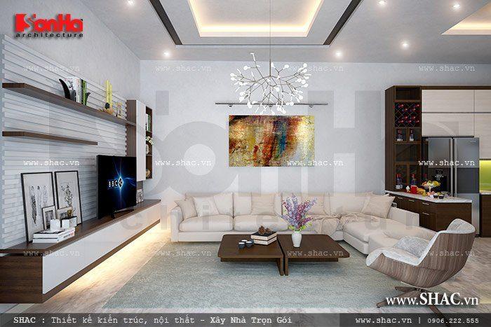 Phương án thiết kế nội thất phòng khách đẹp của biệt thự kiến trúc hiện đại liền kề với các không gian phòng bếp và phòng ăn đem tới sự thuận tiện cho người sử dụng
