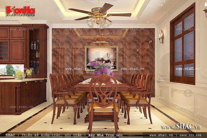 Thiết kế nội thất phòng bếp ăn với bộ bàn ăn sử dụng chất liệu gỗ tự nhiên sang trọng mang đến không gian ấm cúng tiện nghi