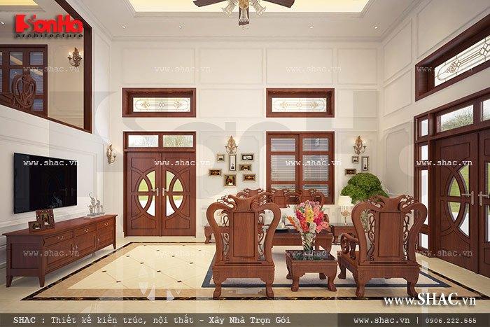Thiết kế phòng khách sử dụng nội thất gỗ đồng kị giản dị nhưng đẹp mắt với thiết kế có chiều sâu
