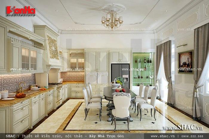 Không gian phòng bếp ăn sáng bừng với nội thất gỗ sang trọng được sắp xếp bố cục tiện nghi và hợp lý