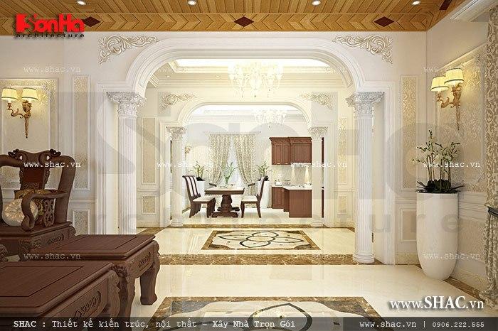 Không gian nội thất sang trọng tại tầng 1 của mẫu biệt thự Pháp 3 tầng được sử dụng làm phòng khách và phòng bếp ăn ngăn nắp