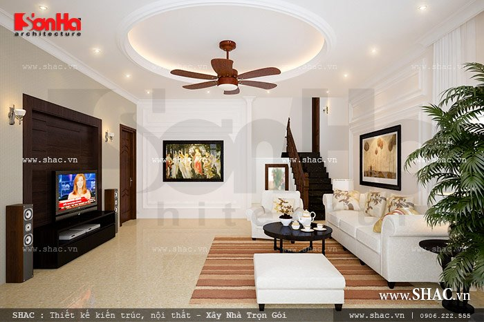 Phòng khách biệt thự tân cổ điển 3 tầng có thiết kế nội thất đẹp từ màu sắc phối hợp đến cách lựa chọn nội thất. Cách bày trí đồ đạc trong căn phòng đơn giản nhưng khoa học và tiện nghi