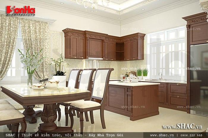 Không gian phòng bếp với thiết kế nội thất tủ bếp và bàn ghế ăn chất liệu gỗ đơn giản nhưng chất lượng được bày trí ngăn nắp khoa học