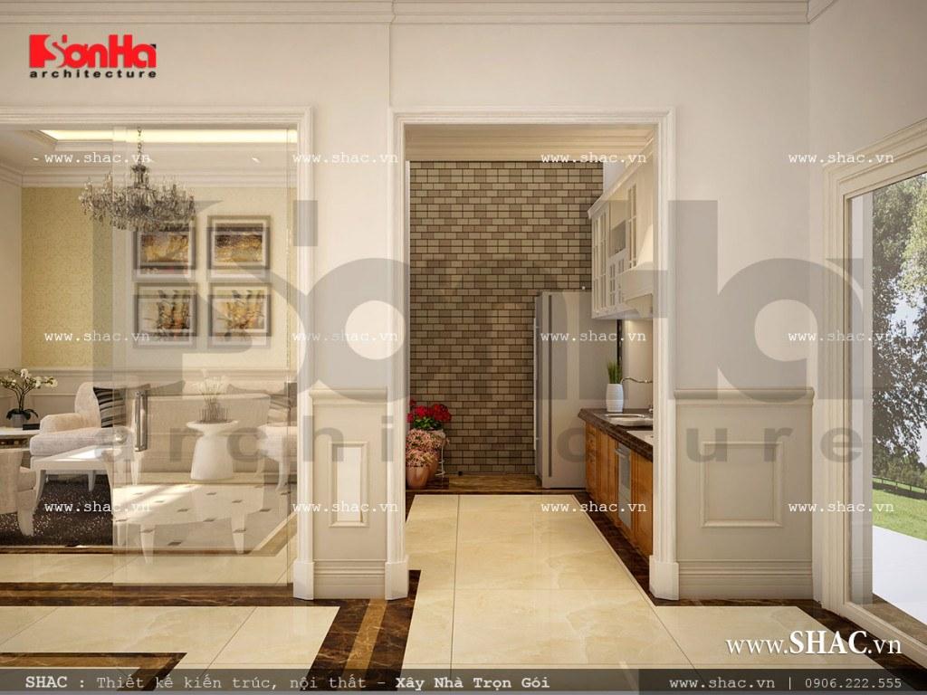Thiết kế nội thất phòng ăn và khu bếp nấu theo hơi hướng cổ điển với màu sắc trắng nổi bật mang đến không gian ẩm thực ấm cúng