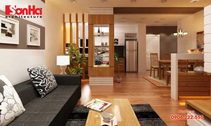 Phòng khách nhà ống đẹp liên thông nhà bếp và nổi bật với nội thất gỗ
