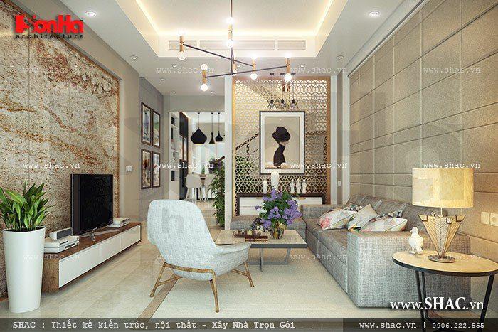 Mẫu phòng khách hiện đại nhà ống nhẹ nhàng và đẹp mắt với gam màu sâu sắc