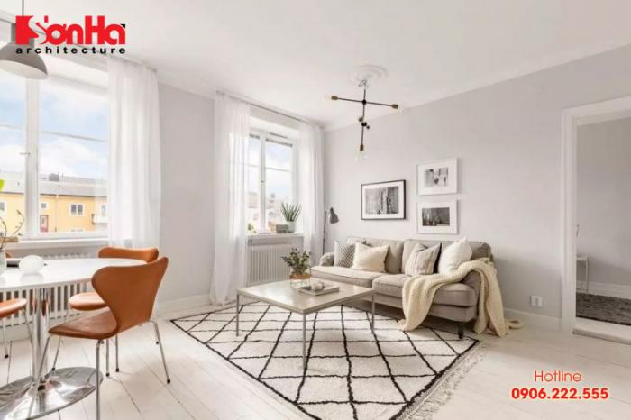 Treo tranh ảnh phù hợp cũng là cách thiết kế phòng khách sáng tạo hợp lý