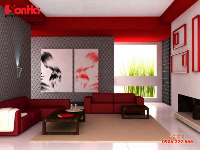 Không gian phòng khách ấn tượng mạnh bởi cách sử dụng màu sắc trắng và đỏ