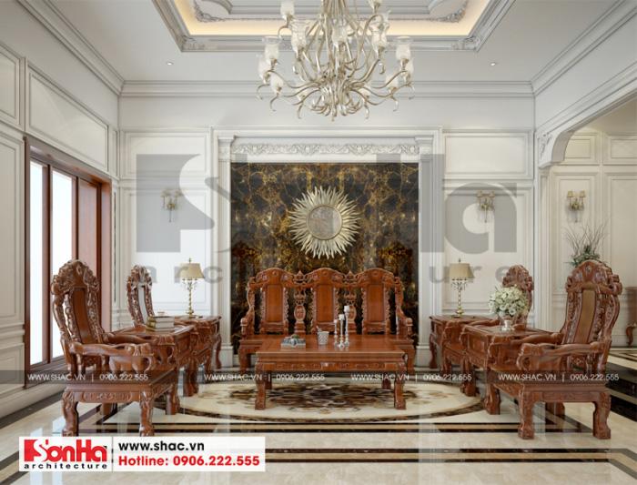 Thiết kế phòng khách đẹp tại tầng 1 với bộ đồng kỵ gỗ tạo bình bắt mắt