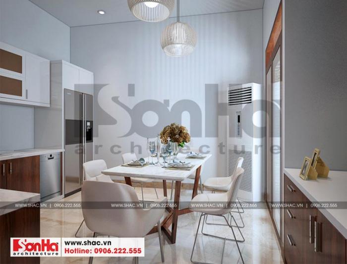 Phòng bếp ăn càng thêm sang trọng với bộ bàn ăn nổi bật về màu sắc và đường nét