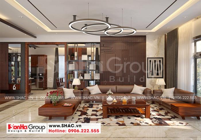 Thiết kế phòng khách biệt thự hiện đại 3 tầng sang trọng với nội thất gỗ