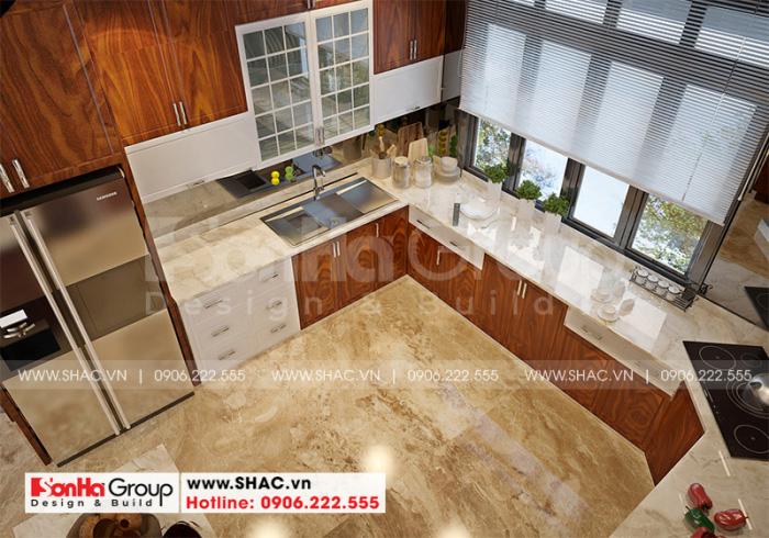 Tủ bếp gỗ chữ L được bố trí đẹp mắt trong không gian phòng bếp ăn