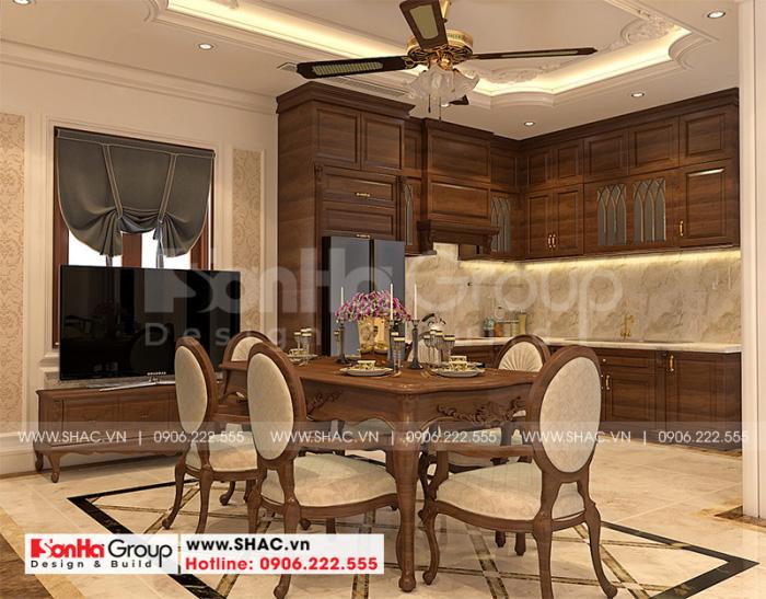 Tủ bếp gỗ được bố trí đẹp và hài hòa trong không gian phòng bếp ấn tượng