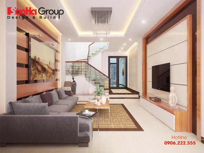 Căn phòng khách nhà ống hiện đại ấm cúng, lịch thiệp được thiết kế sáng tạo với tone màu vàng nhẹ cùng ánh đèn hoàn mỹ