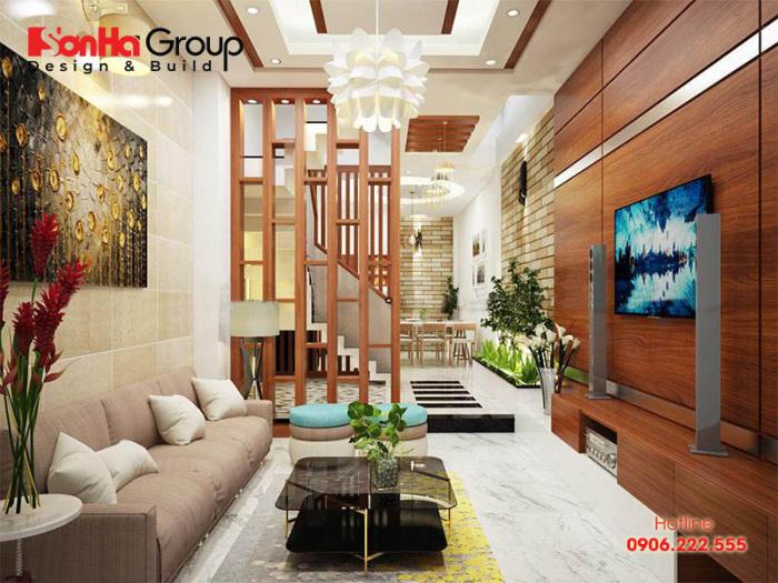 Thiết kế vách ngăn cho phòng khách và phòng bếp tạo sự thông thoáng cho không gian lại tiết kiệm chi phí