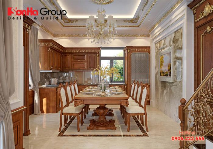 Bộ bàn ăn và khu bếp nấu cao cấp được KTS Sơn Hà thiết kế thi công uy tín, và sang trọng với sắc màu ấm cúng cho ngôi biệt thự