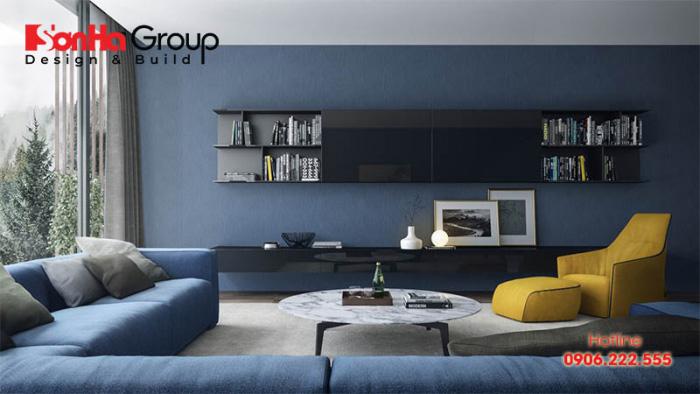 Căn phòng khách với thiết kế màu xanh dương chủ đạo thể hiện cá tính độc đáo của gia chủ