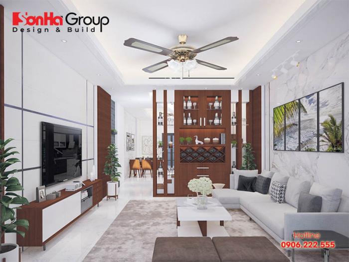 Tính tiện nghi và hiện đại được thể hiện rõ qua mẫu thiết kế nội thất phòng khách liền kề với phòng