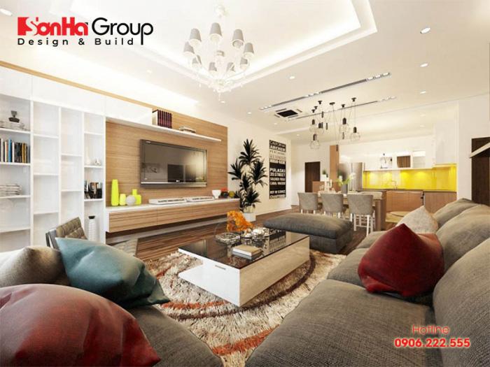 Căn phòng khách nhà chung cư rộng rãi với thiết kế nội thất hiện đại đồng nhất từ kiểu dáng đến màu sắc