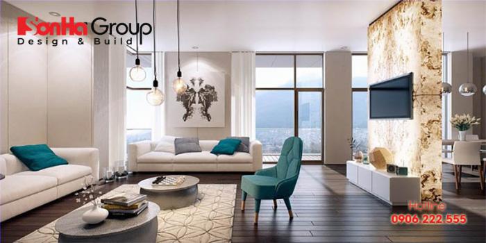 Điểm nhấn của căn phòng khách này đó chính là bộ sofa dài có màu sắc hài hòa