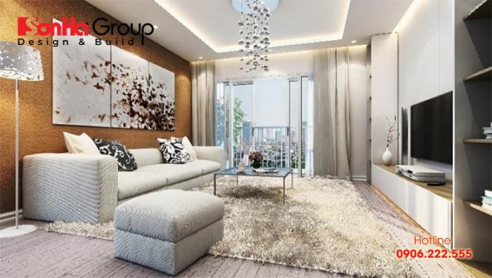 Thảm trải sàn họa tiết độc đáo, kết hợp đèn thả trần mới lạ sẽ là điểm nhấn cho không gian phòng khách căn hộ của bạn