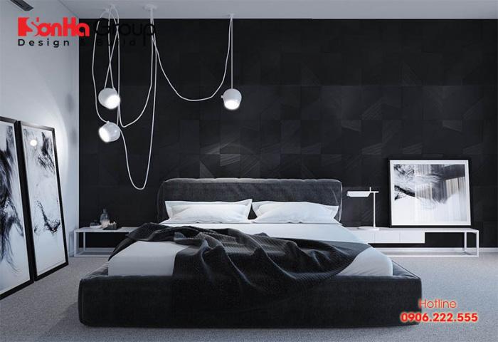 Sử dụng tranh treo tường cũng là một lựa chọn tinh tế cho một căn phòng ngủ tông màu đen trắng. Trong trường hợp này, việc lựa chọn đèn phòng ngủ cũng cần hết sức cẩn thận